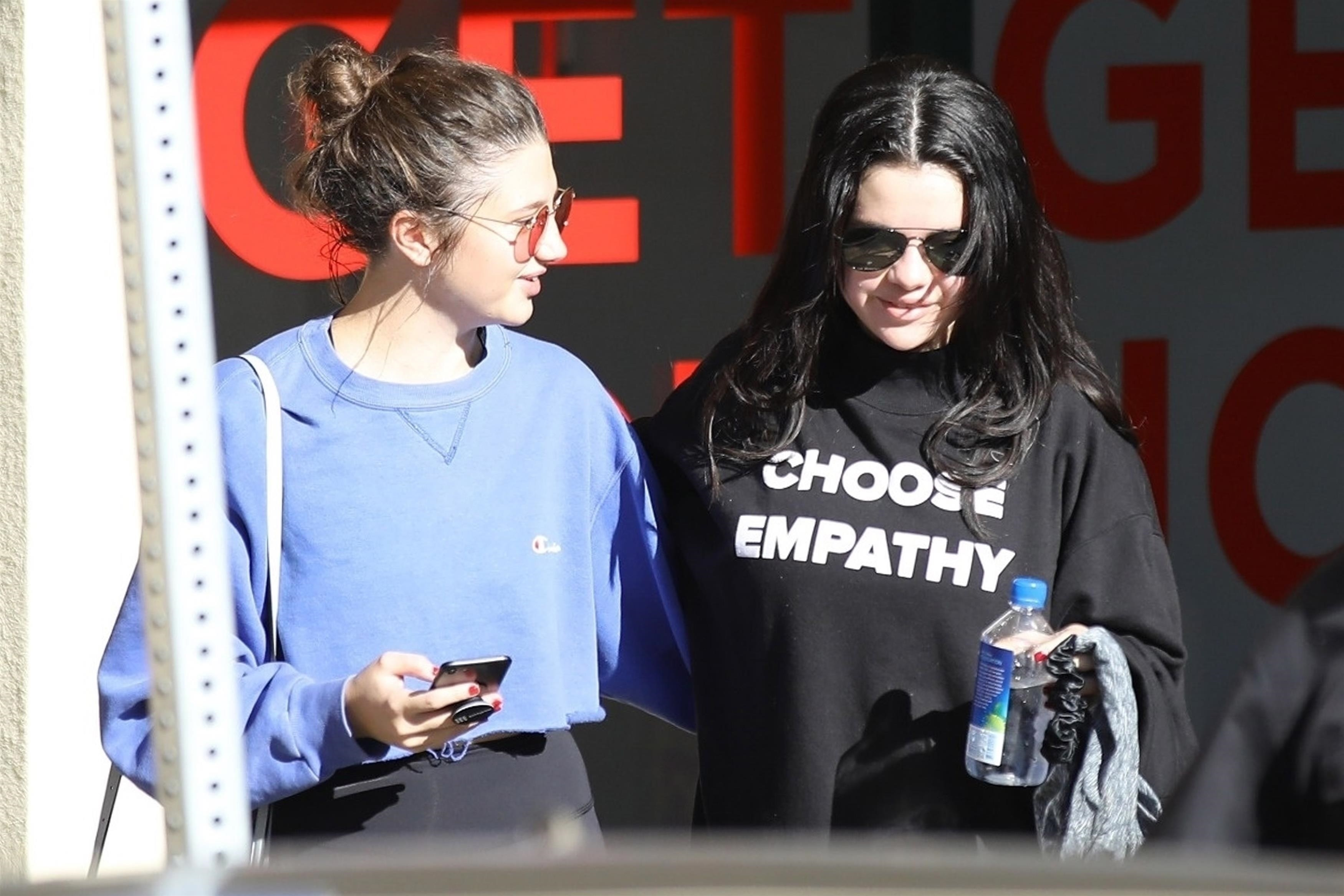 Selena Gomez shows empathy helping out the needy after her pilates class