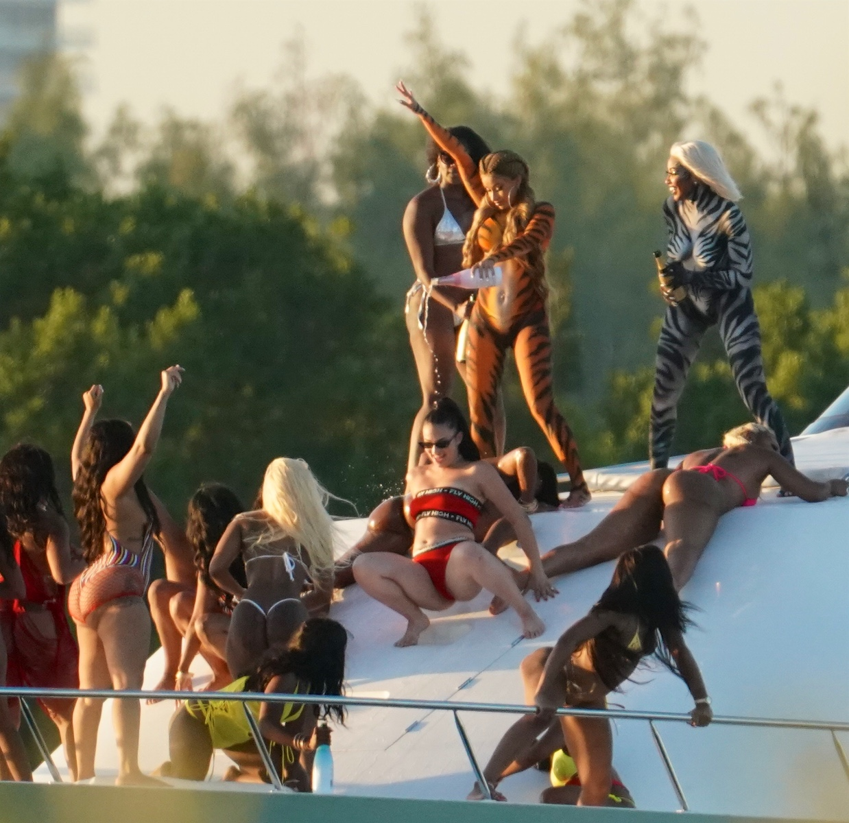 Body-painted Cardi B goes wild on yacht as she films video while splashing champagne