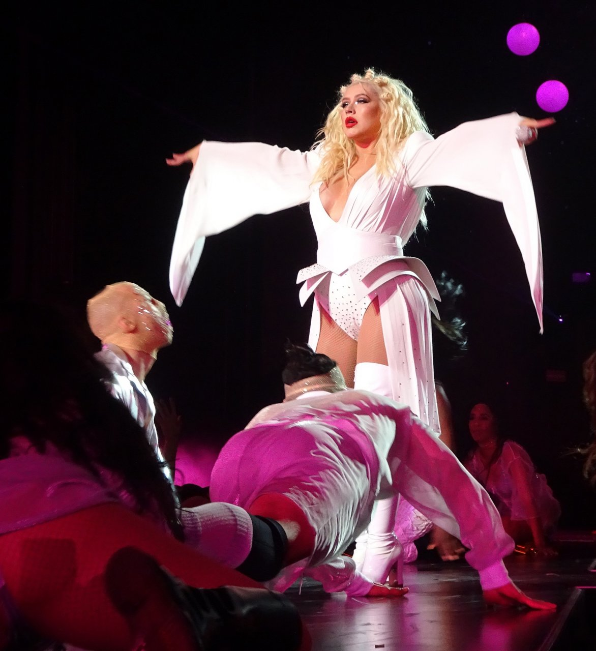 Christina Aguilera has her pasties showing under her first look in all white as she performed for the crowd at her 1st residency show in Sin City