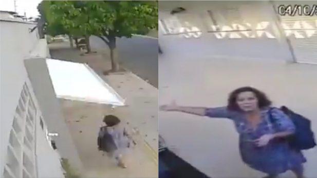 """Senhorinha distraída é """"abduzida"""" por portão de garagem, fica presa dentro da casa de estranhos e implora por socorro para câmera de segurança; assista ao vídeo que viralizou nas redes!"""